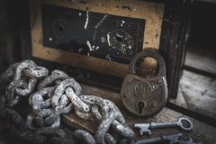 Rusty lock, keys, chain and antique box in wooden case stock photos