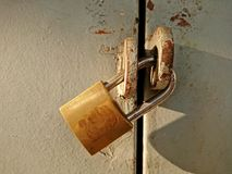 Rusty Lock. An old and rusty lock in used royalty free stock photo