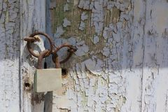 Rusty lock on old wooden door Stock Image