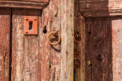 Rusty lock on an old wooden door Stock Images