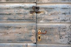 Rusty lock on old wooden doorsc stock image