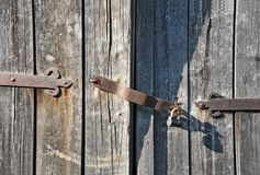 Rusty lock on old wooden gate Stock Photo