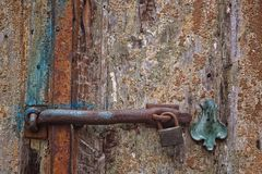 Rusty lock on wooden door Stock Photo