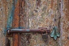 Rusty lock on wooden door Stock Photo