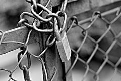 Rusty locking fence with chain stock images
