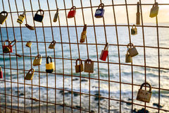 Rusty love locks hanging on the fence as a symbol of loyalty and Royalty Free Stock Image