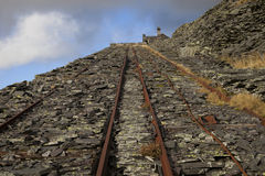 Incline up derelict slate quarry Stock Photo