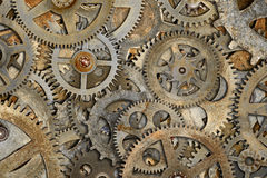 Old Cogs Background. Composite image of rusty clock cogs Royalty Free Stock Photography