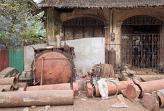 Rusty machine parts on the street in Myanmar Royalty Free Stock Images