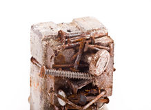 Rusty magnet with screws Royalty Free Stock Image