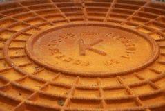 Rusty manhole cover. Closeup of a rusty manhole cover Stock Photography