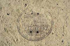 Rusty manhole cover Stock Image