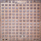 Rusty manhole cover texture Royalty Free Stock Photo