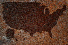 Rusty map of US. Concept recession - map of the US in rust royalty free stock image