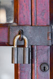 Rusty master key on wood door Royalty Free Stock Photography
