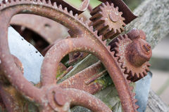 Rusty mechanical machinery gears. Closeup of old machinery wheel and gear sprockets Stock Photography