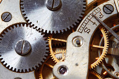 Rusty mechanism in the old clock Stock Photos