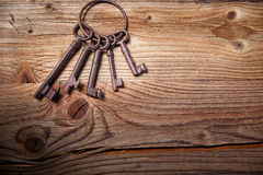 Rusty medieval keys on wood table Stock Photos