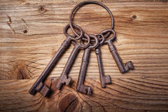 Rusty medieval keys on wood table Royalty Free Stock Images