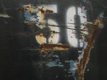 Rusty Metal 50. Rusted damaged metal with spray painted, stenciled number \50 Stock Photos