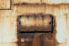 Rusty metal. Old rusting metal inspection panel with broken screws Stock Image