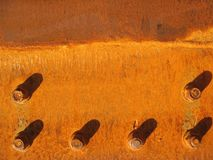 Rusty metal. Plate with bolts Stock Photos
