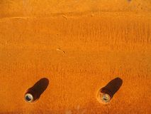 Rusty metal. Plate with bolts Royalty Free Stock Photography