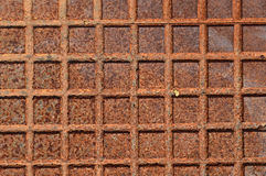 A Rusty Metal Background. A rusty chequered plate manhole cover for use as a background or backdrop Stock Image