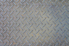 Rusty metal background with non slip repetitive pattern. At industrial floor Stock Images
