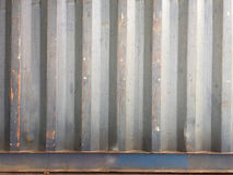 Rusty metal background with old layers of blue paint. Texture rusted shipping container. Stock Photography