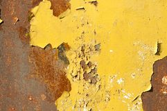 Rusty metal background surface with pealing yellow paint. Rusty metal background surface with pealing yellow paint Stock Photo