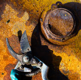 Rusty metal background and tool with with a shadow. Red rusty old metal background for wallpaper and tool with a shadow Royalty Free Stock Image