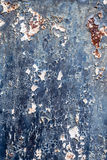 Rusty metal with blue paint flaking off to use as background Royalty Free Stock Photography