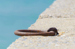 Rusty metal boat hooks on a dock Stock Images