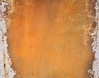 Rusty metal with bright orange paint Royalty Free Stock Photos