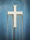 Rusty metal chirstian cross symbol stock photos