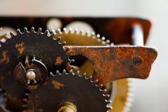 Rusty metal clock mechanism cog gears connection concept. Black iron wheels industrial still life photo. Macro view Stock Photos