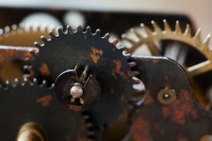 Rusty metal clock mechanism cog gears connection concept. Black iron wheels industrial still life photo. Macro view. Selective focus stock photo