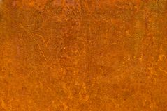 Rusty metal with corrosion orange-brown color. Background of old metal with corrosion orange-brown color, there are scratches. Rusty metal stock photos