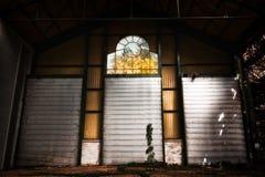 Rusty metal door in an abandoned warehouse Stock Photos
