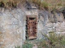 Metal door of concrete bunker. Rusty metal door of cold war concrete bunker royalty free stock photos