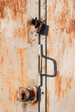 Rusty metal door with the lock Stock Photography
