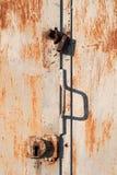 Rusty metal door with the lock. Rusty blue metal door with the lock Stock Photography