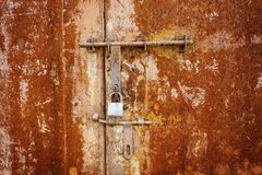 Rusty metal door with lock Royalty Free Stock Image