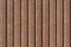 Rusty metal fence, seamless background. Rusty metal texture. Iron, zinc surface rust. Old industrial dirty metal seamless panel. Stock Photo