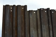 Rusty metal fence section royalty free stock photography