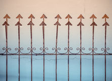 Rusty metal fence with sharp arrows Stock Photography