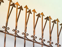 Rusty metal fence with sharp arrows Stock Photo