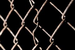 Rusty metal grid on a black background.  Stock Photos