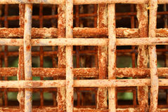 Rusty Metal Grid - Oxidation. Rusty and old metal grid, suitable for eg. a background. When iron, water and oxygen mix, rust happens Stock Photography
